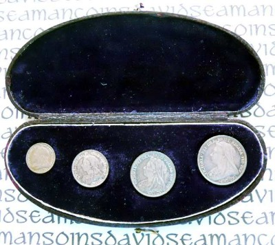 Halfmoon maundy case in black leather open containing a set in black velvet