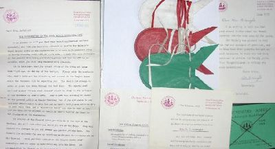 Photo of some of the 1973 letters, ticket and purses.
