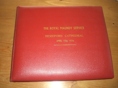 Leather photo album containing photos from the ceremony - 1976